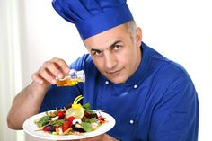 Chef Pouring Olive Oil on a Salad