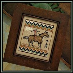 Little House Needleworks Tumbleweeds 1 - The Journey - Cross Stitch Pattern. Model stitched on 30 Ct. Confederate Gray linen with Classic Colorworks and Glorian