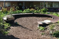 Seating circle- note that the seating is made using planks over old tires - a great idea for around a firepit!