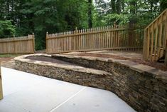 The patio below would have lost many square feet without this wall. The area above was used to make a walkway with stairs that come off the end of the wall. A planting bed was strategically designed and built into the split of this wall. Picture compliments of www.nichegardenslandscaping.com