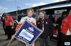 Sage Karam with Micheal Andretti with the pole-winner's flag at Edmonton. #MazdaRoadToIndy