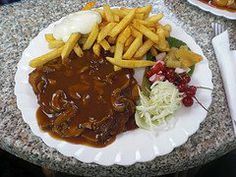 Jägerschnitzel: Jäger Schnitzel (French Escalope à la chasseur) is a court of classical cuisine of fried veal or pork cutlet with a mushroom and tomato or mushroom cream sauce. Regional is now known as Hunter's steak and a fillet of breaded, fried Jagdwurst with tomato sauce.