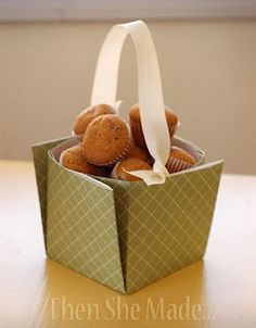 Two versions of a basket from scrapbook paper. How cute is this for taking something to a party or as a hostess gift.