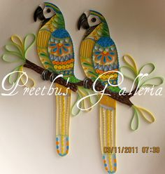 Preethu's Galleria: First UAE Quilling Exhibition - Parrots with Mehndi Design (My mother loves parrots.. going to design her some of these when I get the chance.. ;)