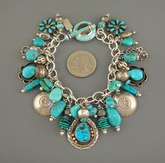 Interesting idea- charm bracelet with only sterling and turquoise charms. Indian Jewelry, Boho Jewelry, Beaded Jewelry, Jewelery, Silver Jewelry, Vintage Jewelry, Jewelry Accessories, Handmade Jewelry, Jewelry Design