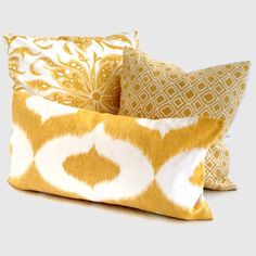 Cool pillows - would look nice with my grey bedding and bright blue sheets! //  yellow patterned pillows