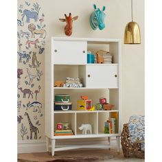 Mid Century French White Bookcase | With an x-base structure and tapered cone-shaped legs, our Mid-Century Bookcase has the feel of a vintage classic with modern day updates such as metal sabot detailing on the legs and a beautiful finish.