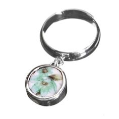 A beautiful reing made in silver and old china by Sägen #nordicdesigncollective #pastel #pastell #light #lightpink #lightblue #lightyellow #lightmint #lightcolor #turquoise #flower #turquoiseflower #china #porcelain #redesign #sagen #silver #jewelry #ring