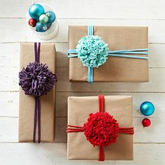 Pom-Pom Gift Topper Give a cheer for smashing pom-poms that make great package tie-ons. Use T-shirt yarn rather than traditional yarn to give them extra fluff.