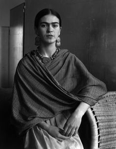 Frida Kahlo by Imogen Cunningham. There is also a gun toting photoshopped image around which uses her head from this photograph.