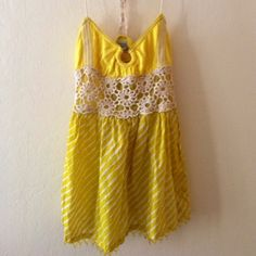 Free People beaded top Free People yellow beaded top with crocheted straps. Small amount if beading missing at the bottom which is reflected in the price. Can't tell when wearing because of the way the shirt falls. Size S. Free People Tops
