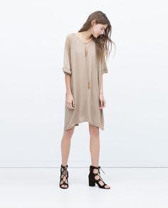 Image 1 de ROBE TUNIQUE À POMPONS de Zara