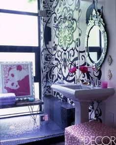 Cynthia Rowley add touches of pink to a small black and white bathroom to create the perfect feminine touch.