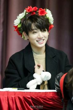 Jungkook with red flowers ~
