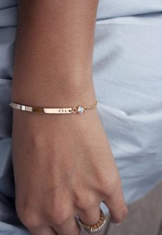 Slim, modern and understated, our personalized gold bar bracelet features a sparkling CZ diamond accent. Customize the front of our birthstone bracelet with a wedding date, a childs name, initials, an anniversary, lovers names etc. for a stunningly simple piece. Our workmanship is excellent, and we use a heavy gauge metal to create all our nameplates which gives this piece a high quality look- bars are rock solid and will not bend out of shape with normal wear. The perfect mom bracelet or…