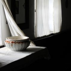rural still life with window and pottery