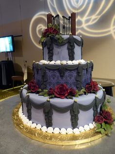 Look at the Haunted Mansion wallpaper on this cake!  I would substitute the Haunted Mansion plaque at the top and use gargoyles instead of roses.  I'm just saying...
