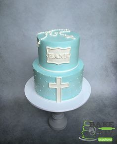 Simple and elegant buttercream baptism cake for a baby boy. Cross, rosary and name plaque.