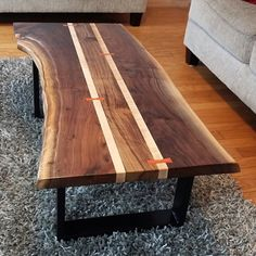 Another view of this live edge coffee table.  The figure of the maple is a little more visible here,  in person it's outstanding.  #liveedge #coffeetable #handmade #walnut