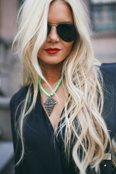 Long hair. Blonde hair. Black sunglass. Red lips.