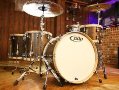 Drum Workshop PDP Walnut drum kit... http://www.drumshop.co.uk/collections/acoustic-drum-kits/products/pdp-cm-classic-4-piece-walnut-with-natural-hoops-shell-pack