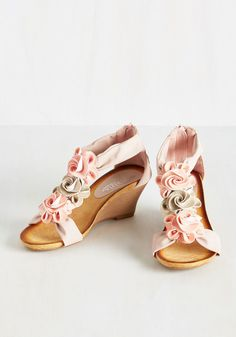 Rosette for the Day Wedge - Let the lovely personality bursting from these stacked wedges bring brilliance to your workday and date night alike! Sitting sweetly in a row atop dusty rose T-straps, pink and metallic rosettes bring feminine fabulousness to this vegan faux-leather pair. You're good to go on great style, girl!