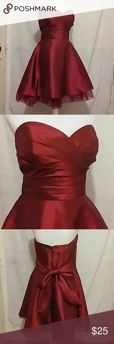 Pressty maids dress size 16, burgundy. This is a burgundy prom dress size 16. Strapless, zips in back, it's around the waist. Armpit to armpit is about 20 in, waist to hem is 18 in but total length is 29 in. 100 percent polyester. Pretty Maids Dresses Prom