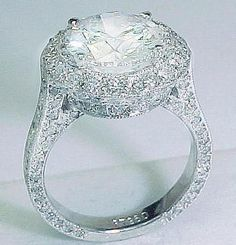 3.18 carat Antique Style Diamond Ring:  Round brilliant diamond in the center set with round pave diamonds on the ring setting.