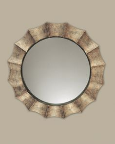Antique frame that features a champagne burnished, silver leaf finish. Contact us to purchase. 41 W X 41 H X 2 D (in)