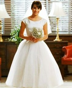 """When Rachel Berry (Lea Michele) married high school sweetheart Finn Hudson (Cory Monteith) on """"Glee,"""" she opted for a '50s-inspired look partially based on Audrey Hepburn's wedding dress in """"Funny Face."""" The dressed was made by the """"Glee"""" team with Los Angeles bridal boutique L'ezu, and although we've had mixed feelings about Michele's off-screen looks, this dress was perfect."""