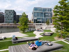 Brand new upmarket residential and office development in old harbour district in Hamburg. Nice urban landscaping here with people enjoying the summer sun.