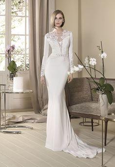 Vestido de novia modelo Glicinia de Cabotine. Confeccionado en crepe con manga larga abotonada. Conoce este vestido nupcial de favorecedor estilo vintage