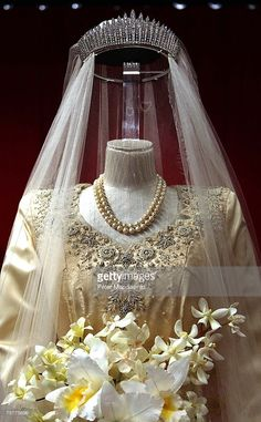 Princess Elizabeth's wedding dress, designed by Norman Hartnell, is displayed at the 'Royal Wedding: 20 Novermber 1957'  exhibition at Buckingham Palace on July 27, 2007 in London. Queen Elizabeth II will be the first reigning sovereign to celebrate a 60th wedding anniversary. This new exhibition will mark the occasion by recreating the day in 1947 when Princess Elizabeth married The Duke of Edinburgh at Westminster Abbey. The collection of archive film footage, behind the scenes…