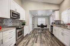 Contemporary Kitchen with Hanover Flat Panel Cabinet Door, Breakfast nook, Galley, Undermount Sink, Subway Tile, Flush