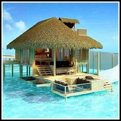 Tropical A Hut Over The Water...  This is where I want to be right now!!