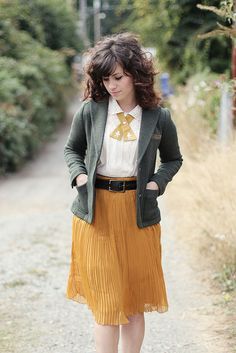 love her grey blazer combined with the mustard flowing skirt! Elizabeth of Delightfully Tacky