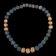 Gold and lapis lazuli necklace.  The Sumerians, more than any other people in the world, loved lapis lazuli. For them, it represented fabulous wealth, literally and as well as figuratively. It is not indigneous to Sumer, and was mined in faraway Afghanistan. Because it had to be imported over vast distances, it was very expensive.