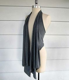Recycle A T-Shirt Into A Vest + Scarf + Shawl by cutting out neckline cutting off sleeves and cutting down the sides.