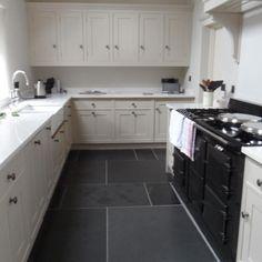 White Kitchen With Black Floor Tiles