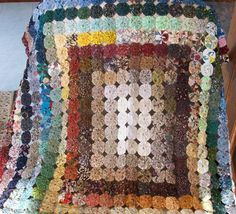 Colors of the Rainbow Yoyo Quilt with directions.
