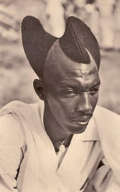 "Tutsi man, 1923. ""The Mohawk has often been worn to impress an adversary, to galvanize warriors in battle or to mark social status,"" writes ..."