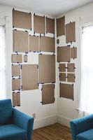 Oh duh! Cut out paper in the size of your frames + prints. Makes wall placement a breeze!
