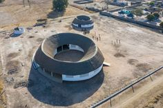 New York-based Toshiko Mori Architect has created a circular building topped with a thatch roof for the Fass School and Teachers Residence in the rural village of Fass in eastern Senegal.