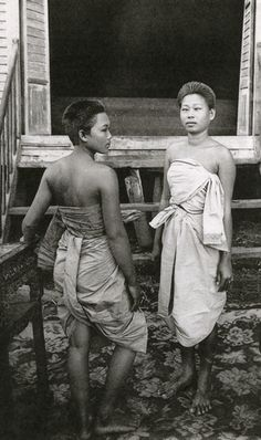 An informal portrait of two women in traditional Cambodian clothing | #Cambodia | © unknown