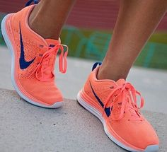 Neon orange nike shoes