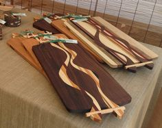 Artistic and unique serving trays/cutting boards created with a blend of indigenous and exotic woods. on Etsy, $96.43