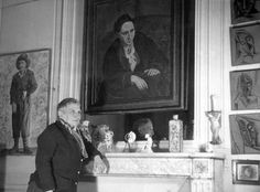 Gertrude Stein in her Paris apartment, with a painting by Picasso.
