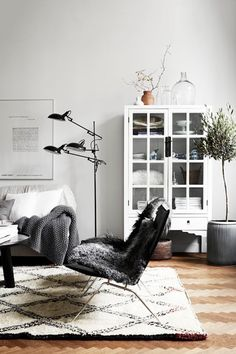 Scandinavian design is one of the most beautiful and elegant ways to decorate your home, and we absolutely love it. This is domino's ultimate guide to decorating your home with a Scandinavian design inspired interior. Rugs In Living Room, Home And Living, Living Room Designs, Living Room Decor, Cozy Living, Nordic Living, Living Spaces, Clean Living, Modern Living