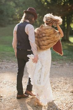 hipster wedding couple - bride with faux fur--