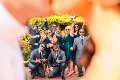 Awesome, unique bridal party shot through bride and groom kissing. Dark teal bridesmaids dresses, matching sunglasses. Hermitage Museum & Gardens in Norfolk, VA. | Common Spark Media | Wedding // Sarah and Ryan | http://www.commonsparkmediablog.com